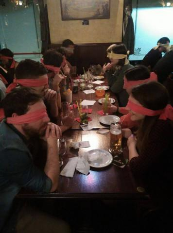 Blindfolded Erasmus eating and talking