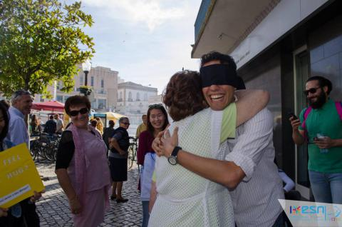 Blindfolded Erasmus hugging a local